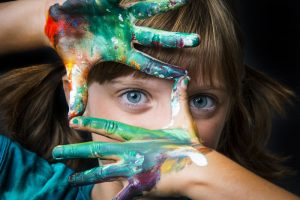 Girl With Colors On Hand
