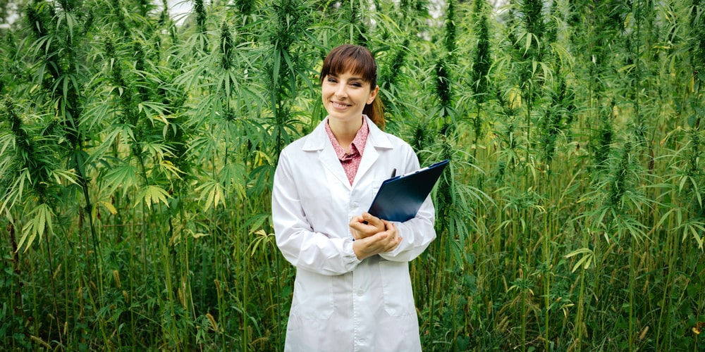 Confident Female Doctor Posing In Front Of Hemp Doctor